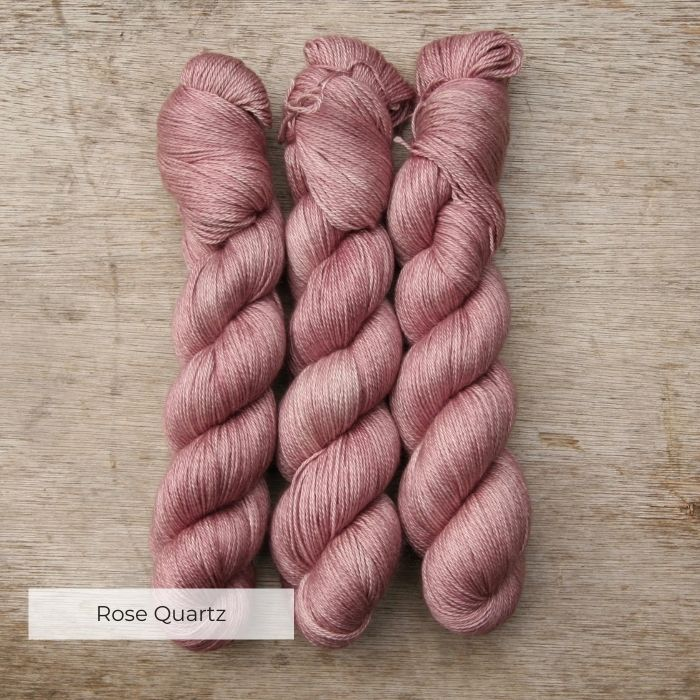 Three skeins of soft and silky pink yarn