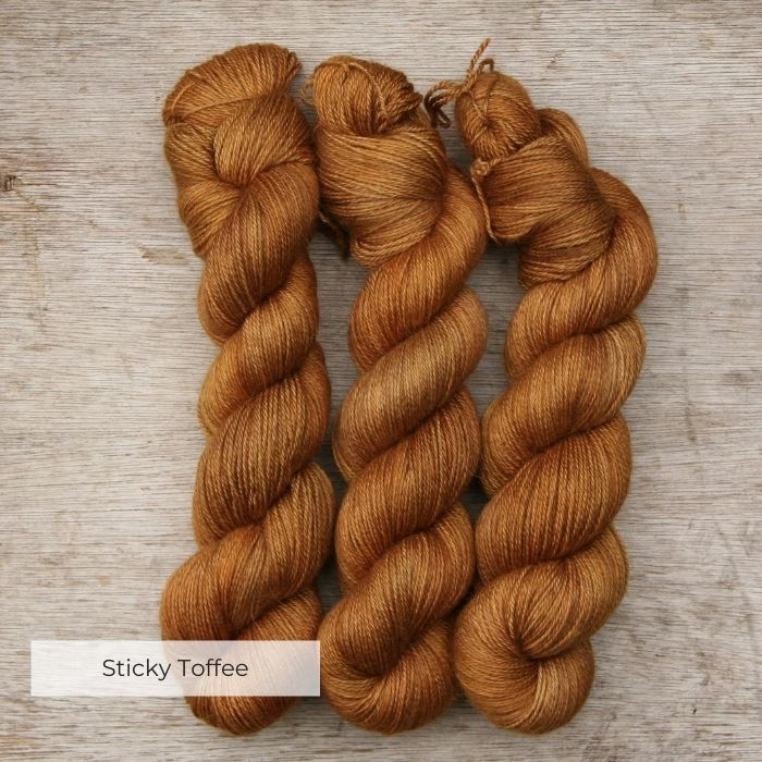 Three skeins of alpaca yarn in ginger