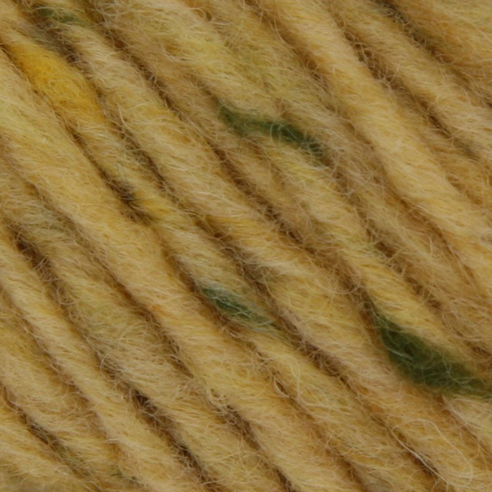 A close up of a soft, butter yellow yarn with flecks of green and cream
