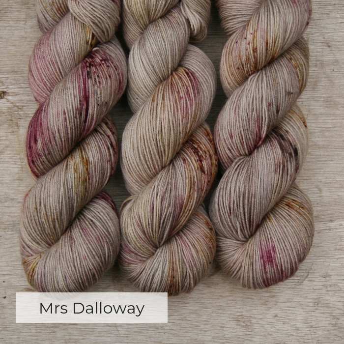 Three skeins of pinky taupe wool with gold , raspberry and brown speckles
