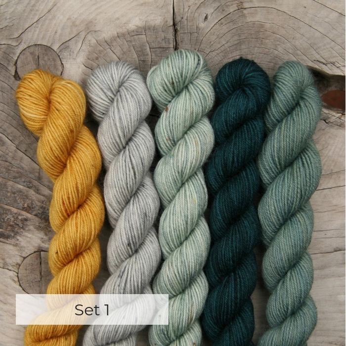 Five mini skeins yellow, grey and blue greens