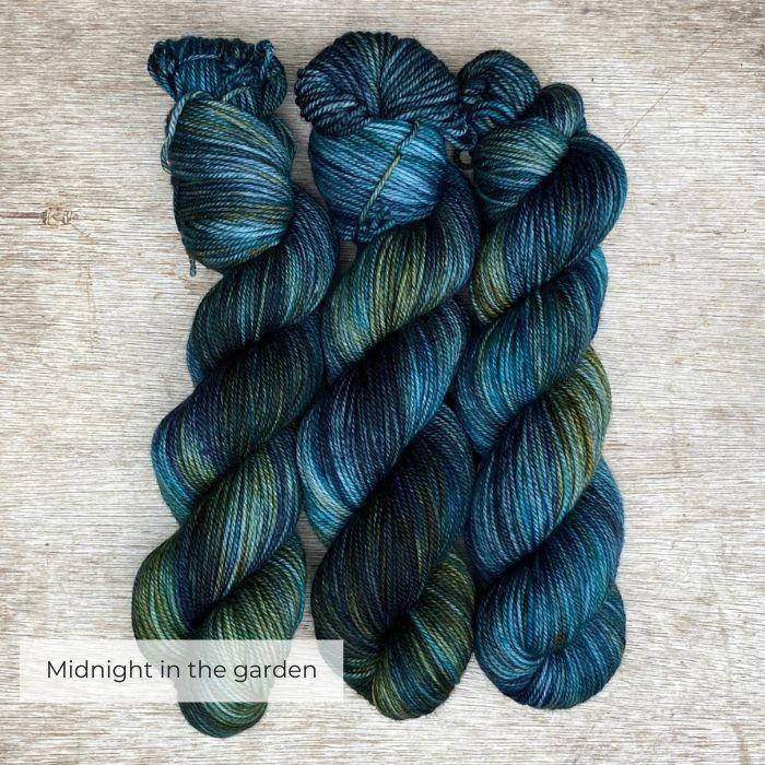 Three skein of dark blue black mohair and silk