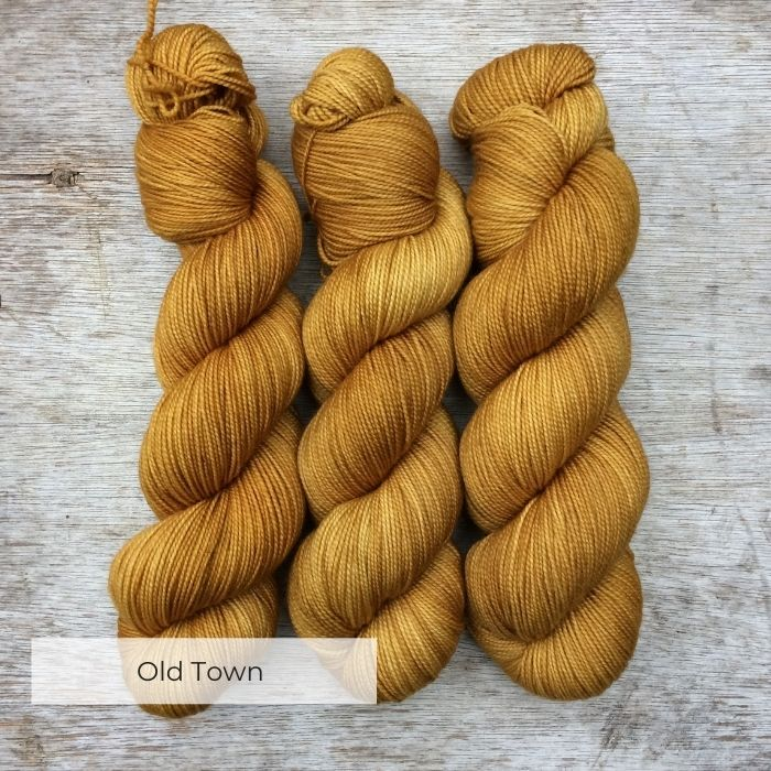 Three skeins of a golden mustard yarn