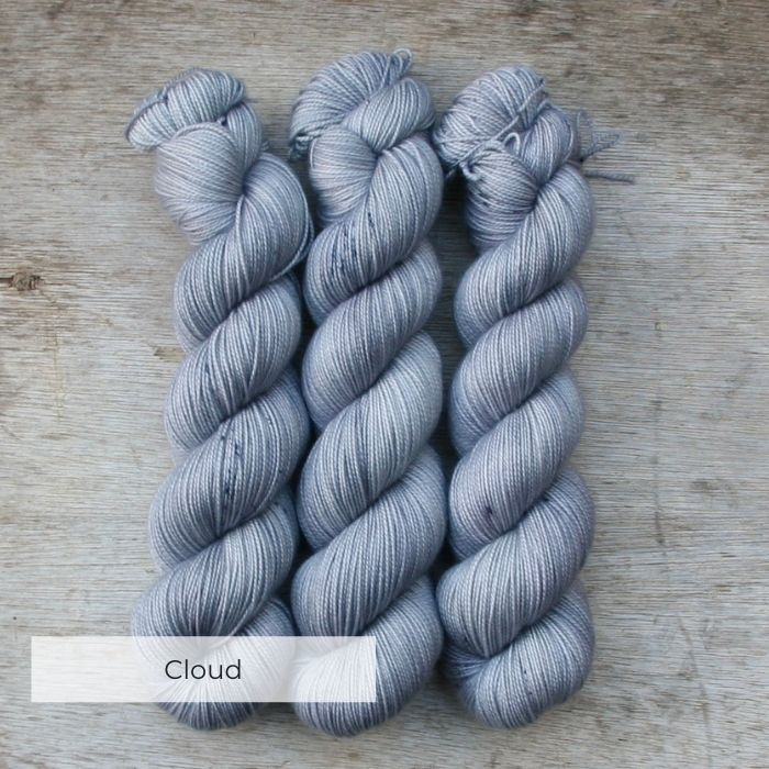 Three skeins of the softest grey with darker speckles