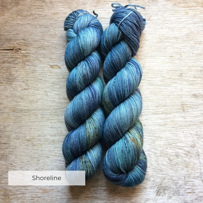 Two skeins of yarn the colours of a deep blue sea