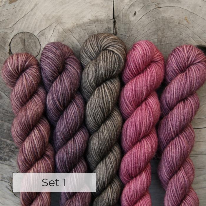 Five mini skeins raspberry pink, dark mauve, grey brown, two pink s