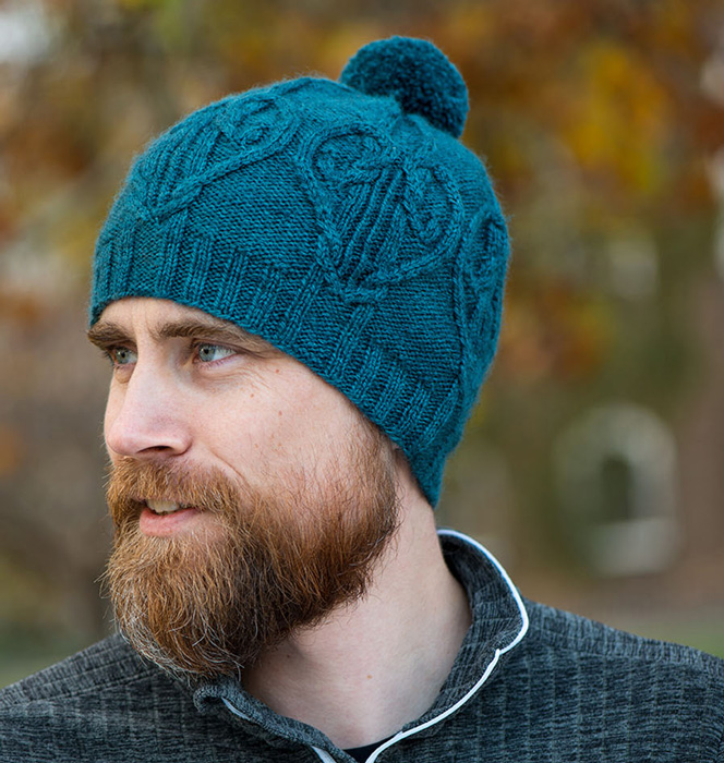 Man wearing knitted cabled hat