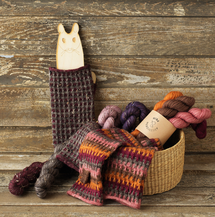 Mittens and wool in a basket
