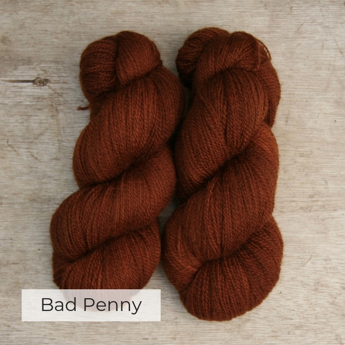 Two skeins of slightly heathered copper coloured yarn