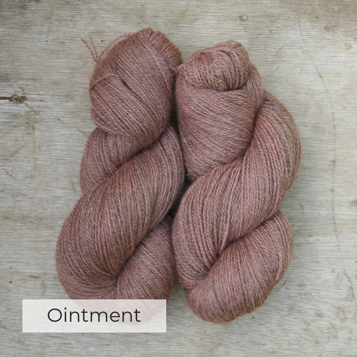 Two skeins of slightly heathered pink yarn