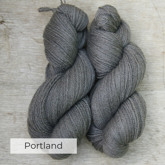 Two skeins of slightly heathered light grey yarn