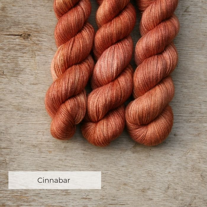 The skeins of soft, silky terracotta alpaca yarn