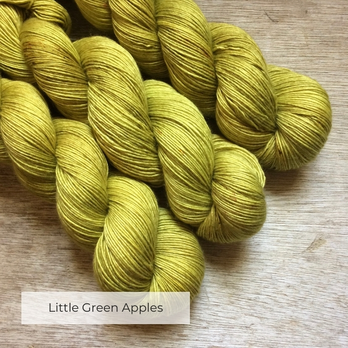 Three skeins of silky merino in a soft acid green