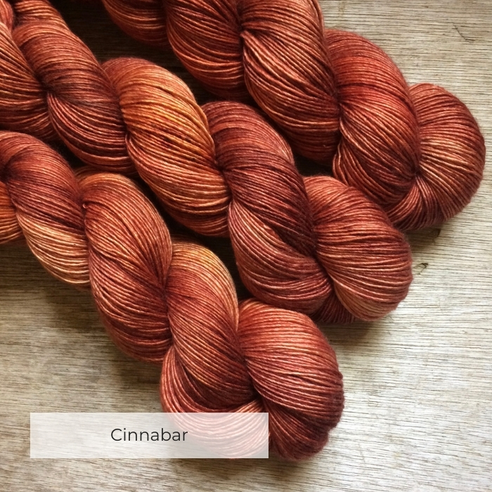 Three skeins of terracotta yarn