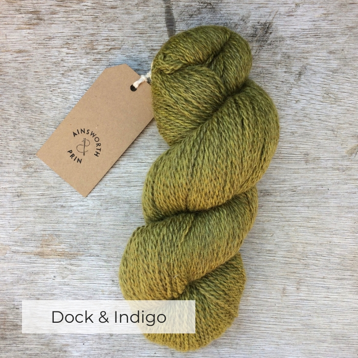 A single skein of naturally dyed yarn in a acid green colour