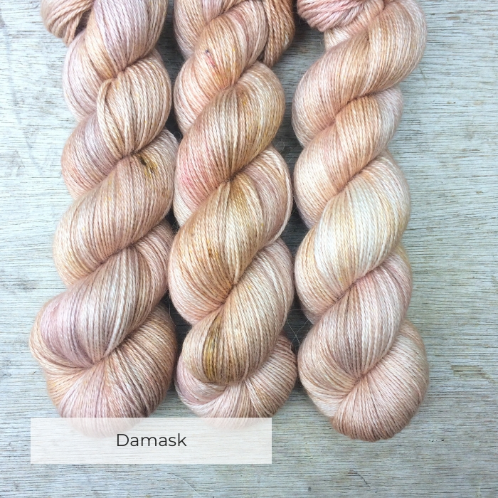 Three skeins of soft, silky alpaca the colour of whitewashed terracotta