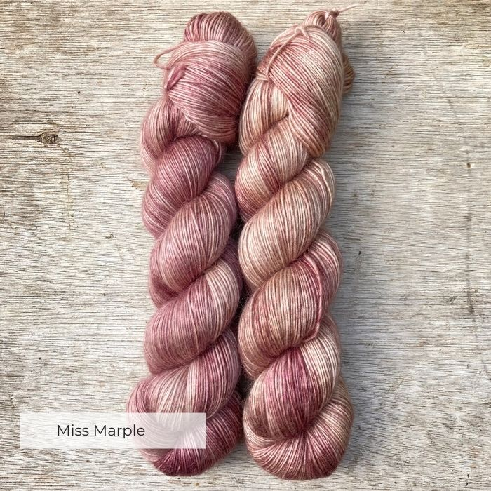 Two skeins of dusky pink yarn