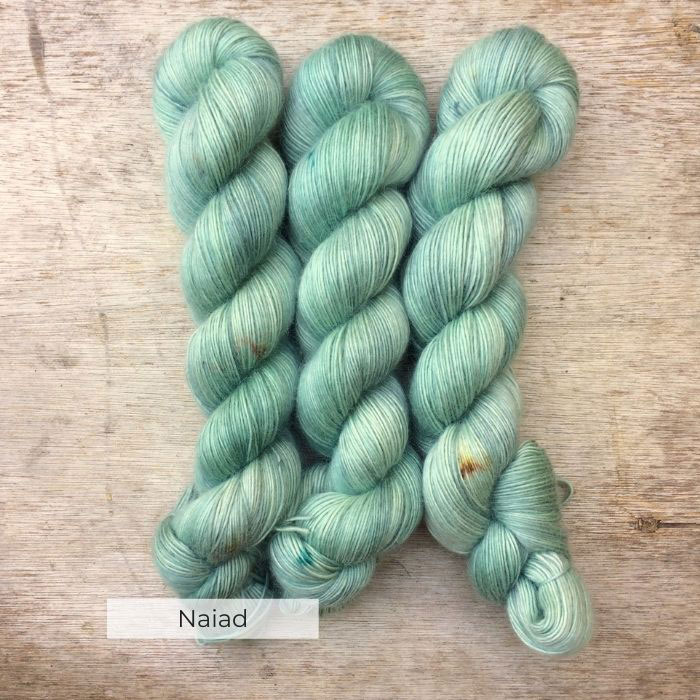 Three skeins of soft and slightly fluffy yarn in cool mint greens