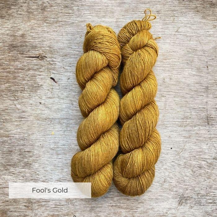 Two skeins of deep golden ochre yarn