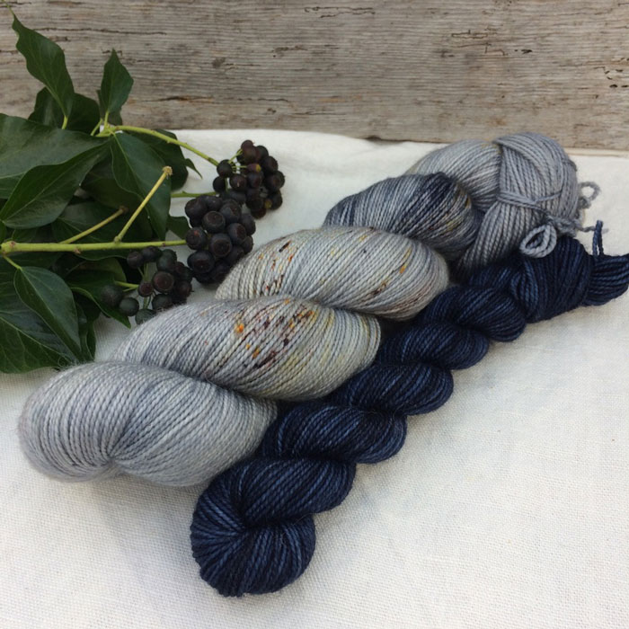 Two skeins of yarn in shades of blue