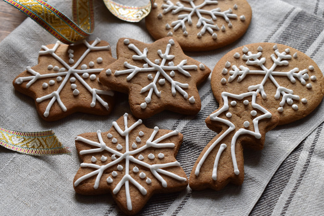 Iced gingerbread snowflakes and stars on a teatowel