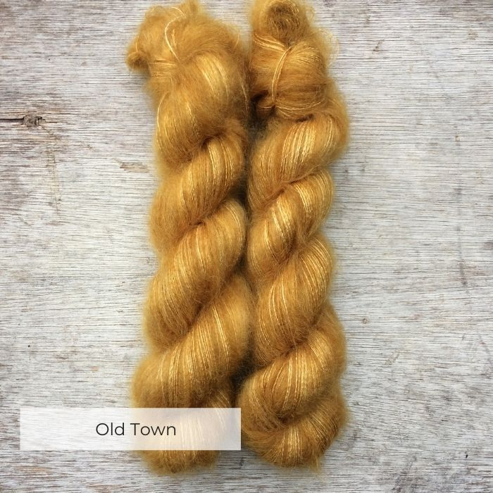 Two silky skeins of mohair in a rich mustard yellow