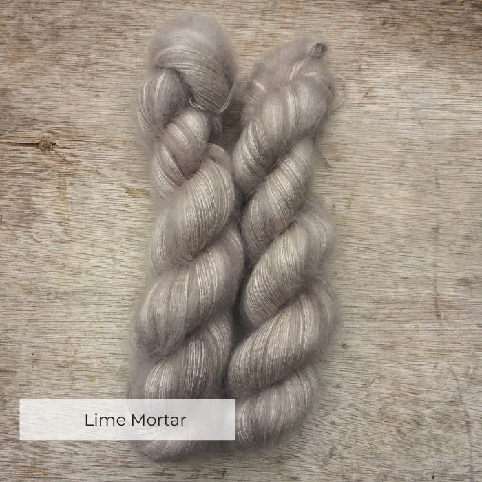 Two plump skeins of soft grey mohair and silk