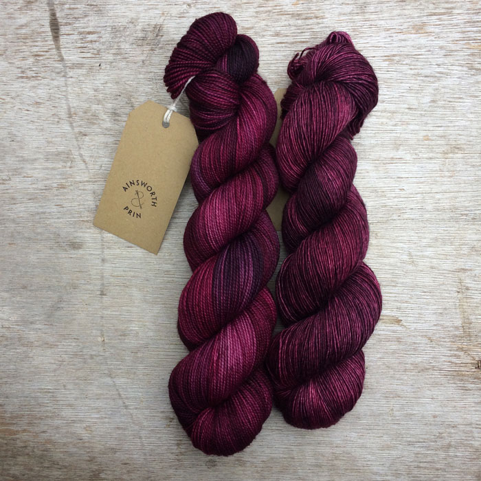 Two skeins of yarn in the same colour but different bases so they're slightly different