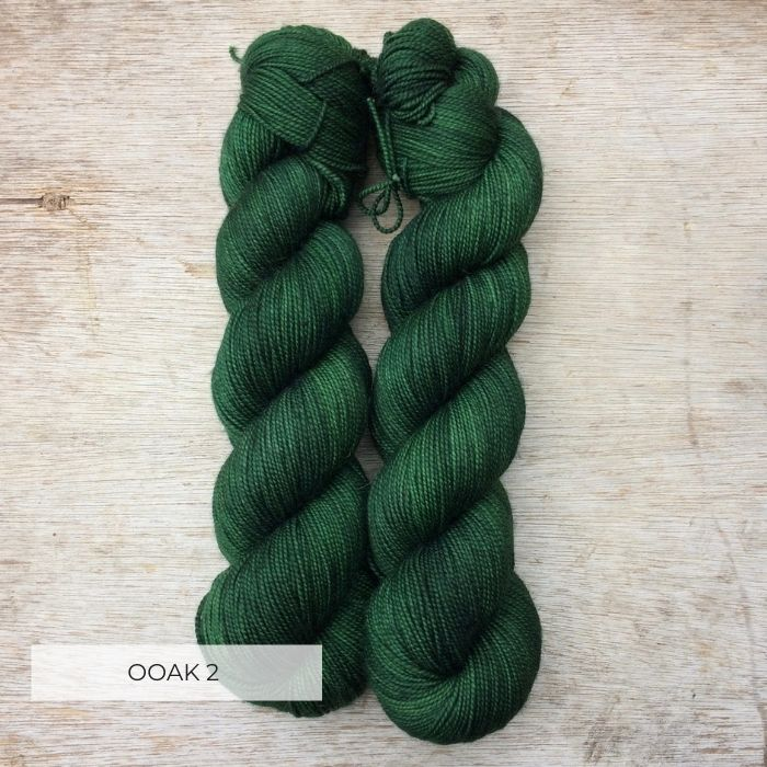 Two skeins of deep bottle green