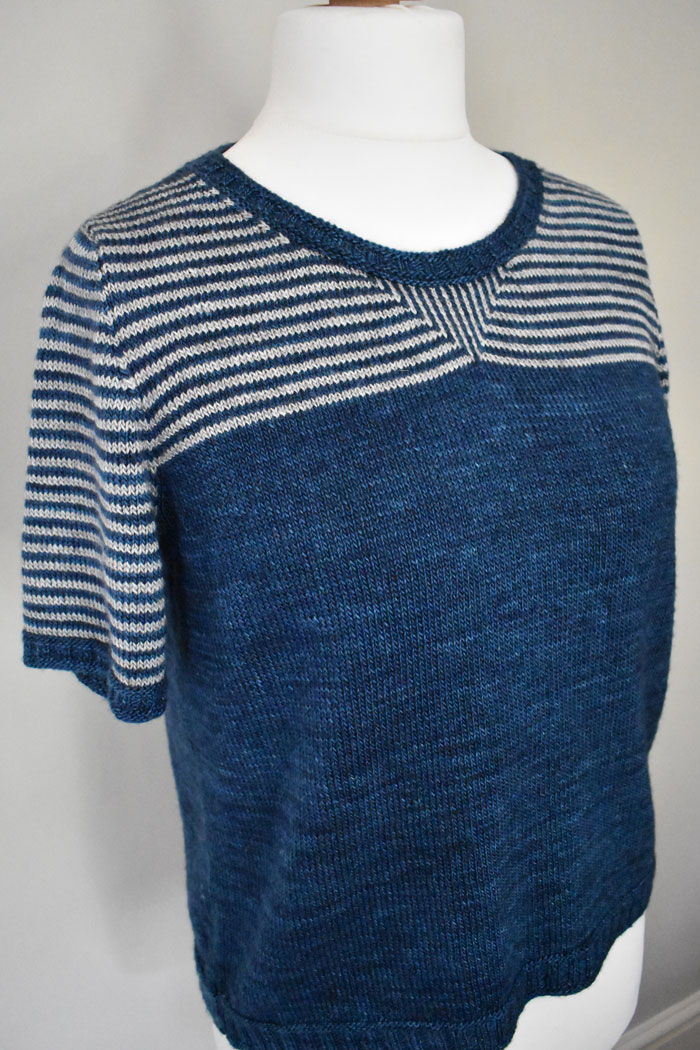 A blue and grey stripped knitted T shirt