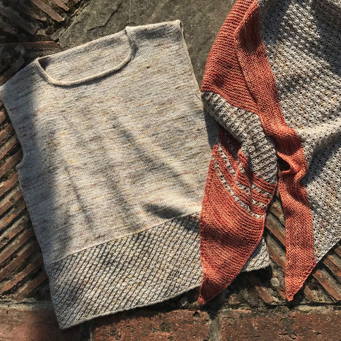 A summer top and coordinating top on a brick background