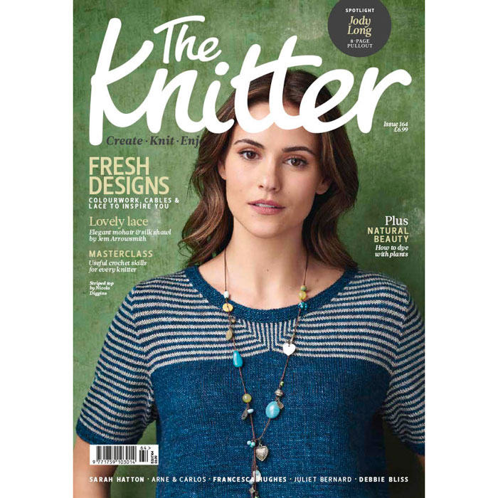 A photo of a magazine cover with a woman wearing a striped teal t-shirt
