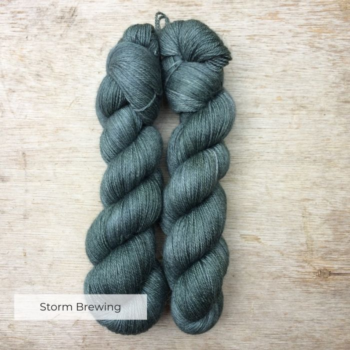 skeins of soft alpaca yarn the colour of the deep sea
