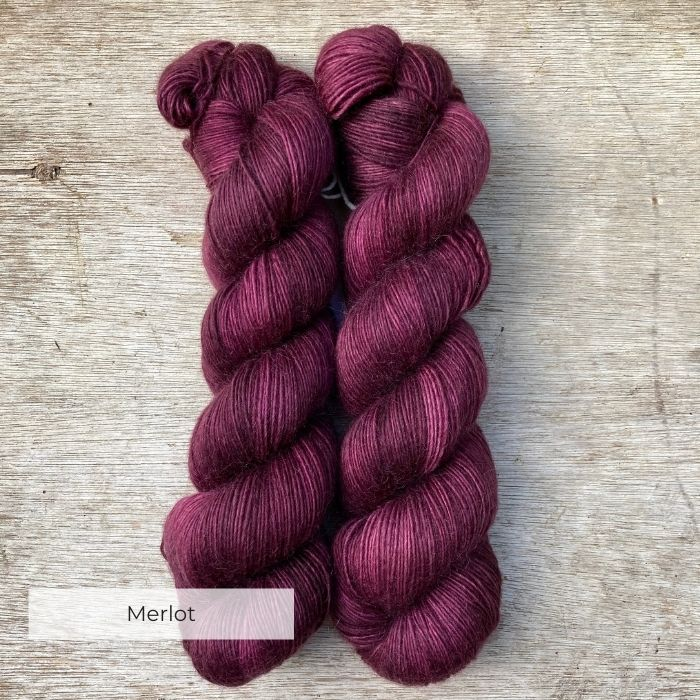 Two skeins of rich wine red yarn